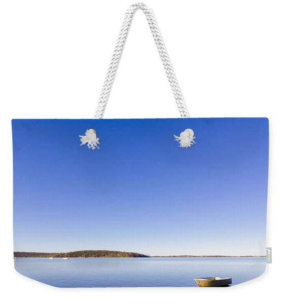 Small Boat Anchored Out To Sea Weekender Tote Bag