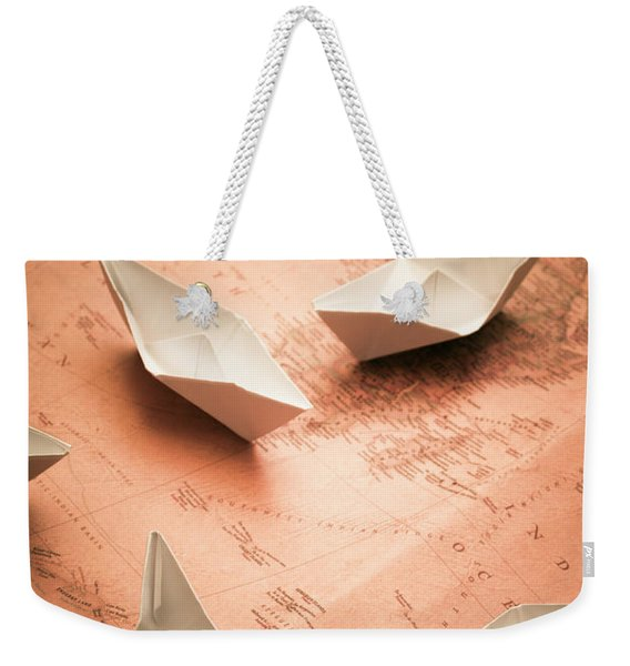 Small Paper Boats On Top Of Old Map Weekender Tote Bag