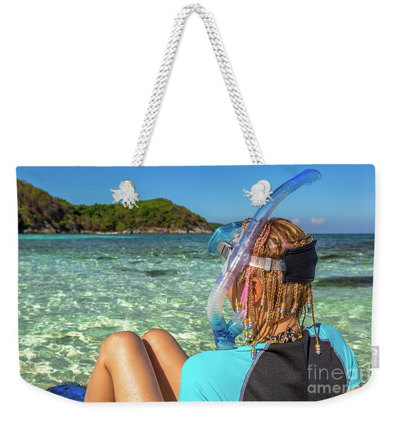 Weekender Tote Bag featuring the photograph Snorkeler Relaxing On Tropical Beach by Benny Marty