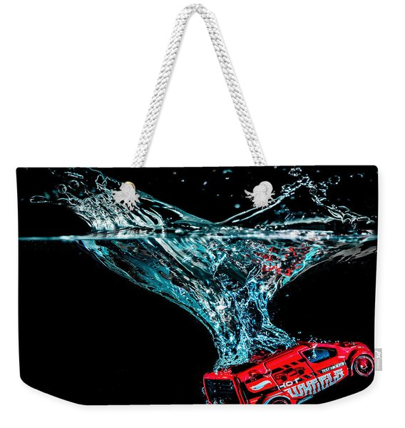 Weekender Tote Bag featuring the photograph Splash Down by Nick Bywater
