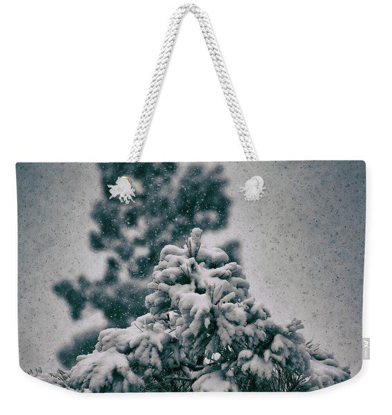 Weekender Tote Bag featuring the photograph Spring Snowstorm On The Treetops by Jason Coward