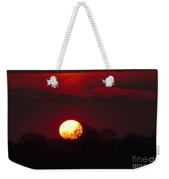 Weekender Tote Bag featuring the photograph Spring Sunset by Jeremy Hayden