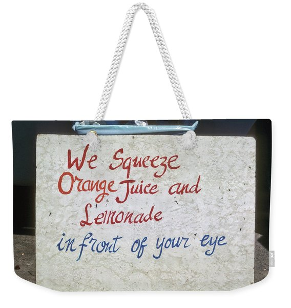 Weekender Tote Bag featuring the photograph Squeezed Juice Sign by Frank DiMarco