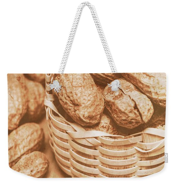 Still Life Peanuts In Small Wicker Basket On Table Weekender Tote Bag