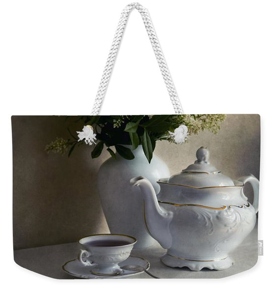 Weekender Tote Bag featuring the photograph Still Life With White Tea Set And Bouquet Of White Flowers by Jaroslaw Blaminsky