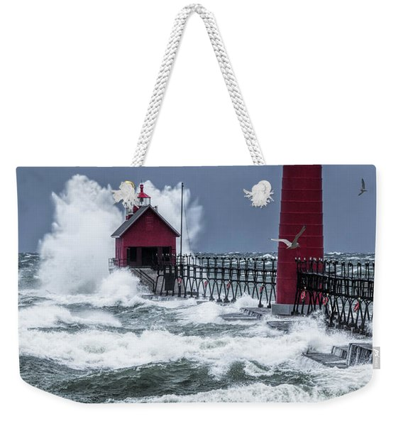 Storm On Lake Michigan By The Grand Haven Lighthouse With Flying Gulls Weekender Tote Bag