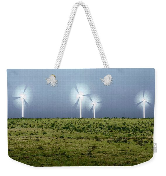Weekender Tote Bag featuring the photograph Storms And Halos by Scott Cordell