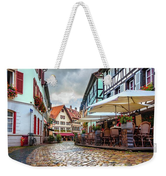 Weekender Tote Bag featuring the photograph Street Cafe After The Rain by Dmytro Korol