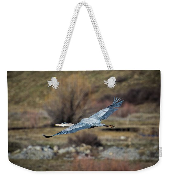 Weekender Tote Bag featuring the photograph Stretched Wide Open by Jason Coward