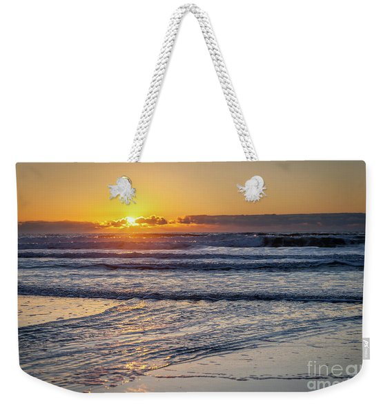 Sun Behind Clouds With Beach And Waves In The Foreground Weekender Tote Bag