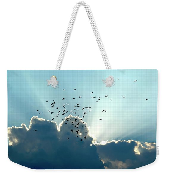 Weekender Tote Bag featuring the photograph Sun Ray Aerobatics Blue Sky by Carolyn Marshall
