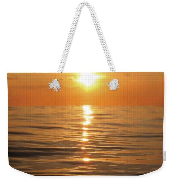 Sun Setting Over Calm Waters Weekender Tote Bag