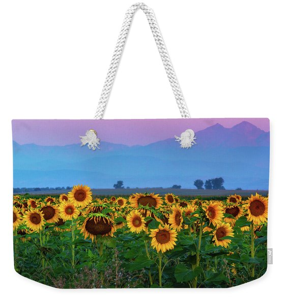 Weekender Tote Bag featuring the photograph Sunflowers At Dawn by John De Bord