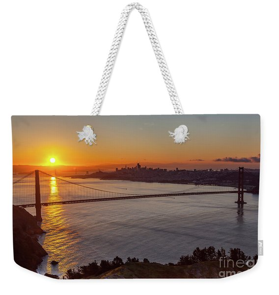 Sunrise Sunlight Hitting The Coastal Rock On The Shore Of The Go Weekender Tote Bag