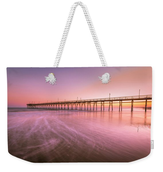 Weekender Tote Bag featuring the photograph Sunset Beach Fishing Pier In The Carolinas At Sunset by Ranjay Mitra
