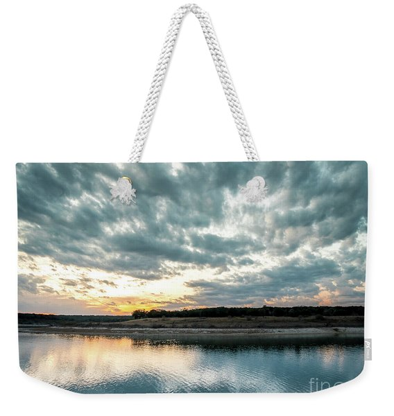 Sunset Behind Small Hill With Storm Clouds In The Sky Weekender Tote Bag