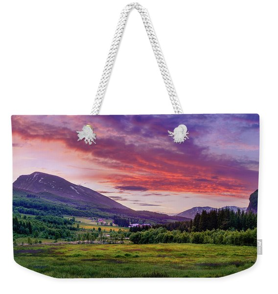 Weekender Tote Bag featuring the photograph Sunset In The Meadow by Dmytro Korol