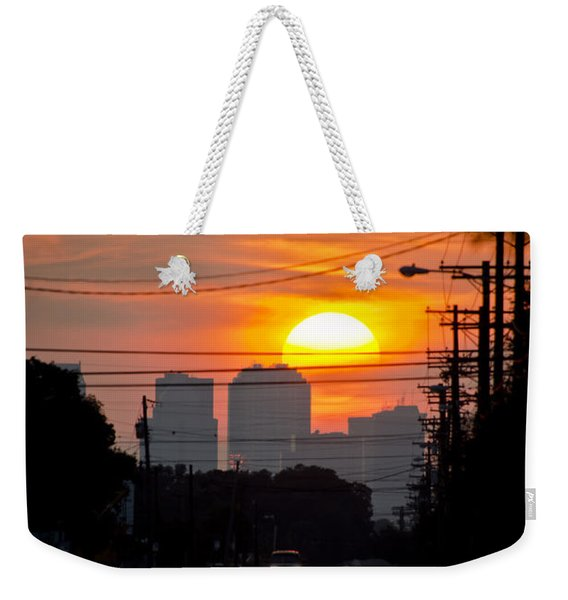 Weekender Tote Bag featuring the photograph Sunset On The City by Carolyn Marshall