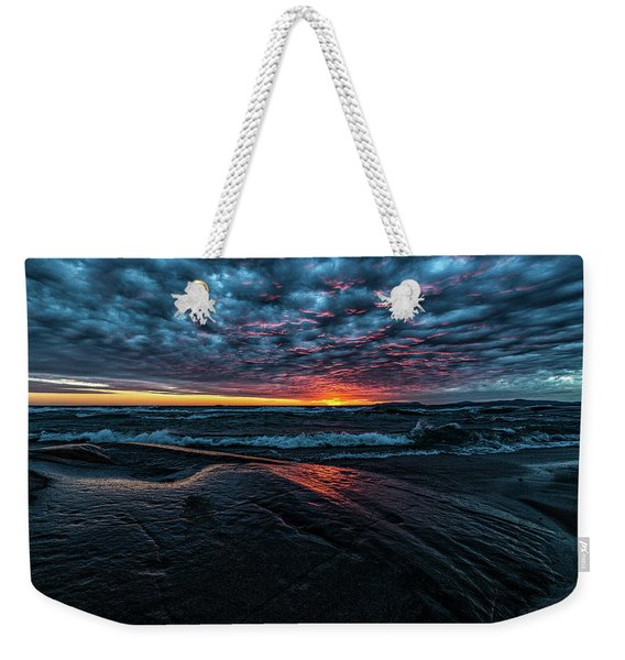 Weekender Tote Bag featuring the photograph Sunset Surf by Doug Gibbons