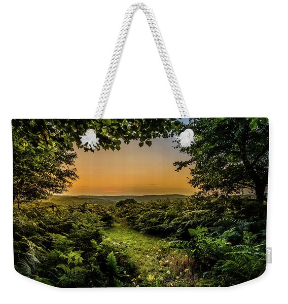 Weekender Tote Bag featuring the photograph Sunset Through Trees by Nick Bywater