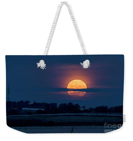 Weekender Tote Bag featuring the photograph Super Moon by Arik Baltinester