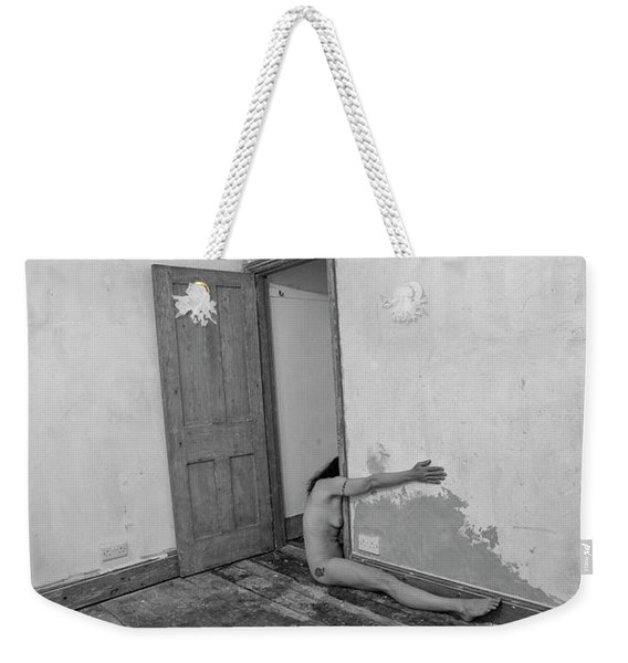 Weekender Tote Bag featuring the photograph Surreal Half Nude In Doorway by Clayton Bastiani