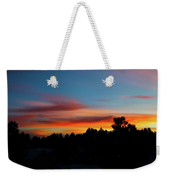 Weekender Tote Bag featuring the photograph Surreal Sunset by Jason Coward