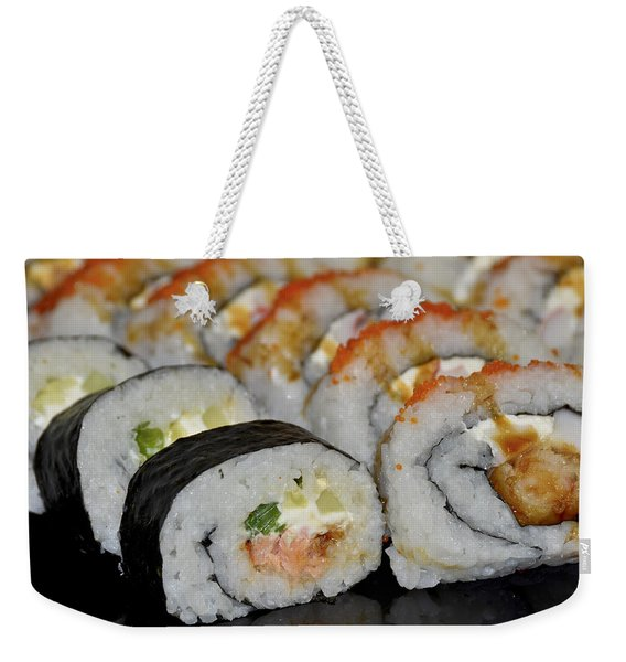 Weekender Tote Bag featuring the photograph Sushi Rolls From Home by Carolyn Marshall