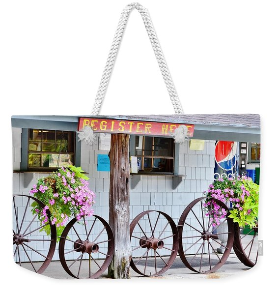 Weekender Tote Bag featuring the photograph Wagon Wheels by Kim Bemis