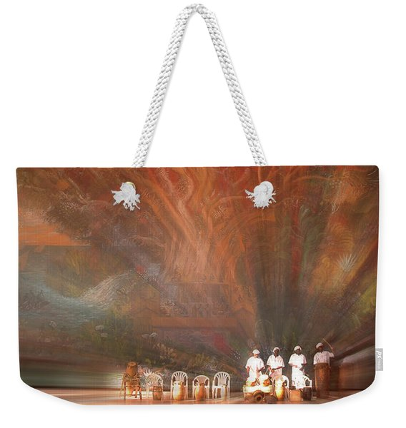 Weekender Tote Bag featuring the photograph The Drumbeat Rising by Wayne King
