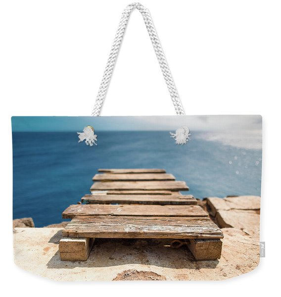 Weekender Tote Bag featuring the photograph The Infinite Blue by Break The Silhouette