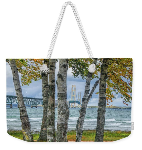 The Mackinaw Bridge By The Straits Of Mackinac In Autumn With Birch Trees Weekender Tote Bag