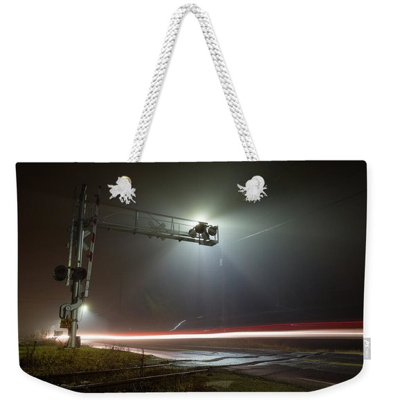 Weekender Tote Bag featuring the photograph The Speed Of Light by Brian Hale