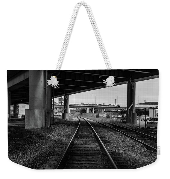 Weekender Tote Bag featuring the photograph The Tracks And The Overpass by Break The Silhouette