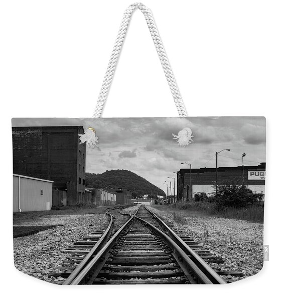 Weekender Tote Bag featuring the photograph The Tracks by Break The Silhouette
