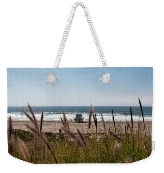 Weekender Tote Bag featuring the photograph Through The Reeds by Lorraine Devon Wilke