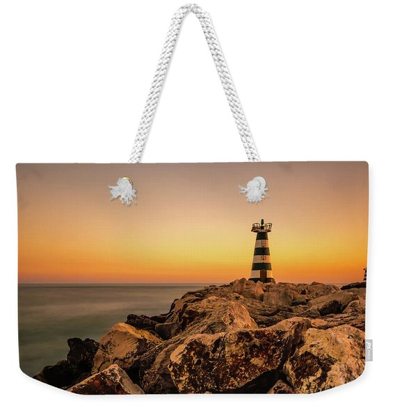 Weekender Tote Bag featuring the photograph Tower Of Light by Nick Bywater