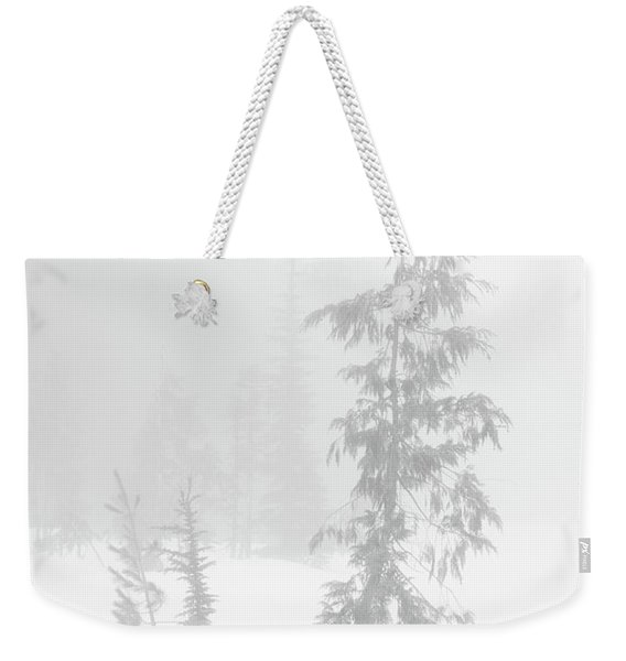 Weekender Tote Bag featuring the photograph Trees In Fog Monochrome by Tim Newton