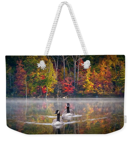 Two Canadian Geese Swimming In Autumn Weekender Tote Bag