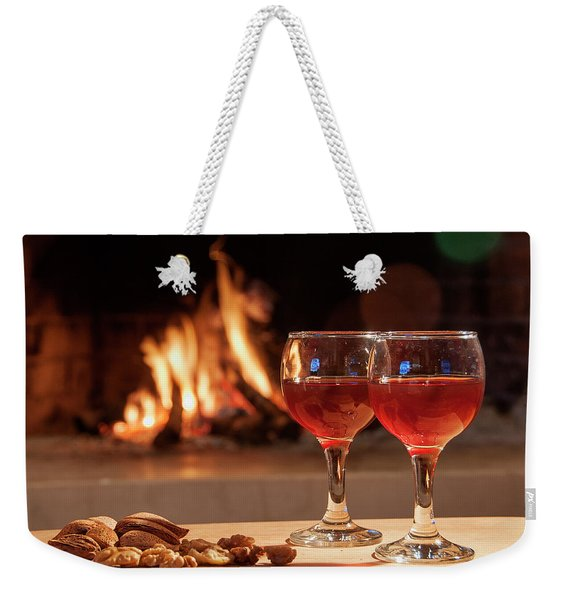 Two Glass Of Wine In Front Of A Fireplace Weekender Tote Bag
