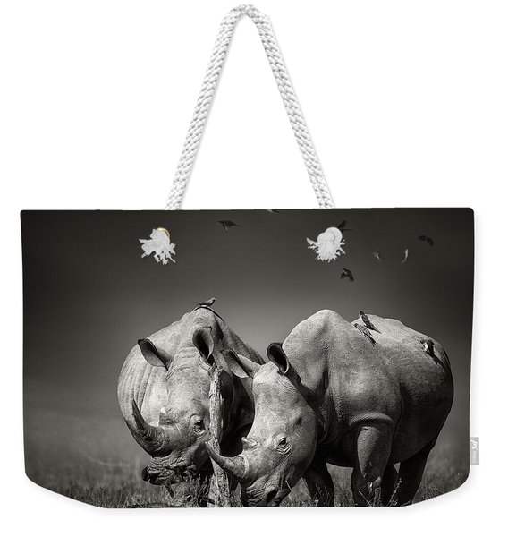 Two Rhinoceros With Birds In Bw Weekender Tote Bag