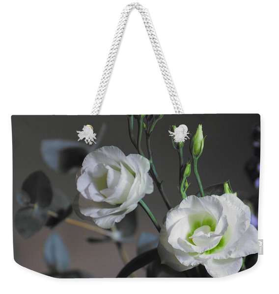 Weekender Tote Bag featuring the photograph Two White Roses by Jeremy Hayden