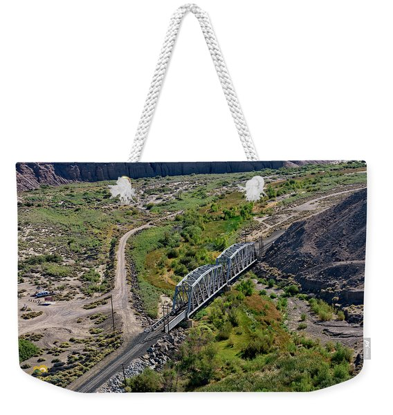 Weekender Tote Bag featuring the photograph Up Tracks Cross The Mojave River by Jim Thompson