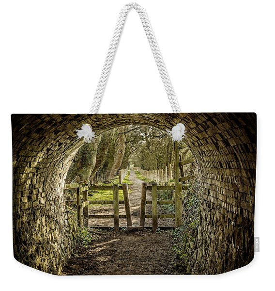 Weekender Tote Bag featuring the photograph View From The Tunnel by Nick Bywater