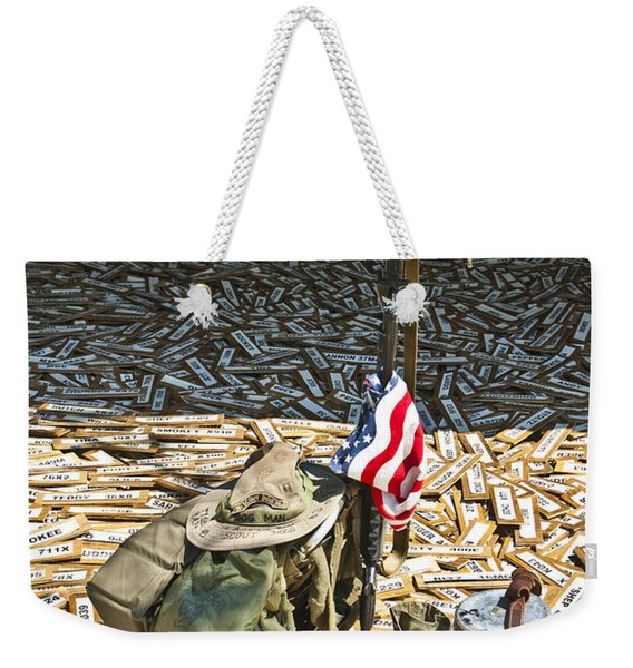 Weekender Tote Bag featuring the photograph War Dogs Sacrifice by Carolyn Marshall