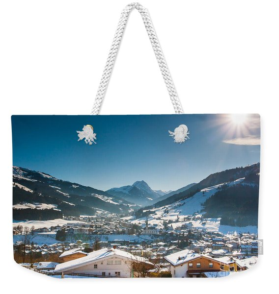 Weekender Tote Bag featuring the photograph Warm Winter Day In Kirchberg Town Of Austria by John Wadleigh