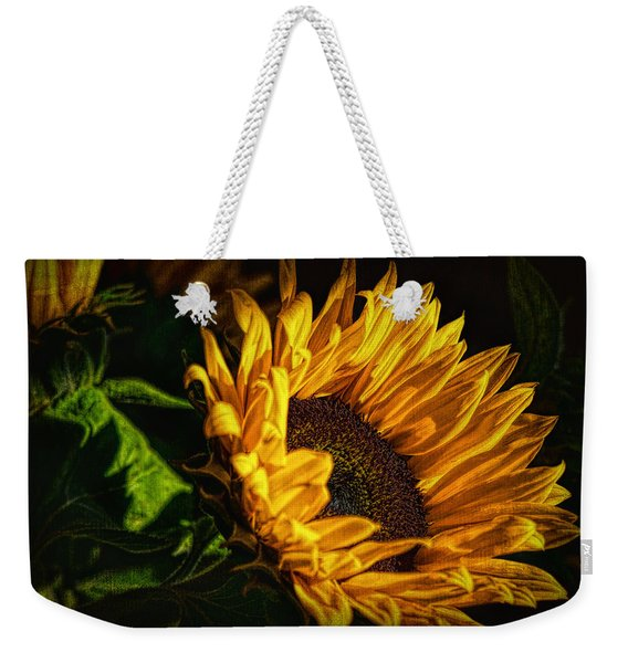 Weekender Tote Bag featuring the photograph Warmth Of The Sunflower by Michael Hope