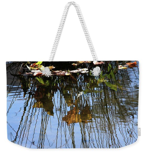 Water Reflection Of Plant Growing In A Stream Weekender Tote Bag
