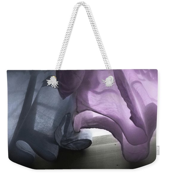 Weekender Tote Bag featuring the photograph A Wave Of Shirts by Wayne King