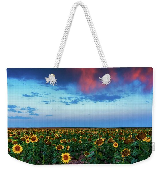 Weekender Tote Bag featuring the photograph When Clouds Dance by John De Bord